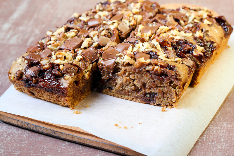 Chocolate and oat cake with nuts, selective focus